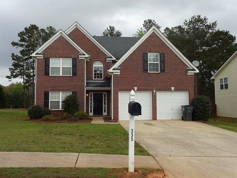 Photo of 335 Cobblestone Ct, Hampton, GA 30228