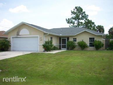525 Oakfield Ave, Lehigh Acres, FL 33974